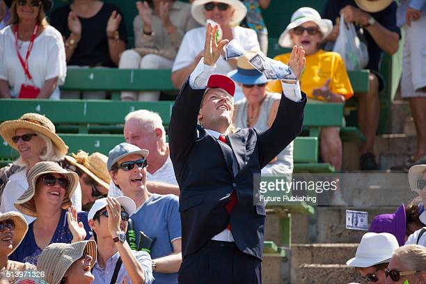 Donald Trump impersonator gives out fake money as Bernard Tomic and John Isner play in the Davis Cup 1st Round AUS Vs USA on March 6 2016 in...