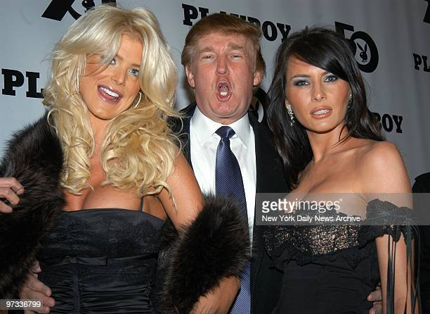 Donald Trump is flanked by Victoria Silvstedt 1997 Playmate of the Year and his girlfriend Melania Knauss at Playboy magazine's 50th anniversary...