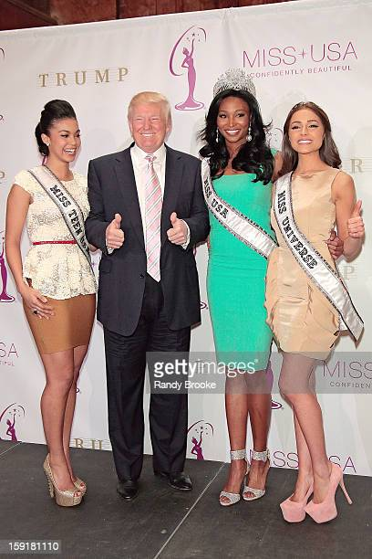 Donald Trump is two thumbs up while surrounded by Miss Teen USA Logan West the new Miss USA Nana Meriwether and the former Miss USA and now Miss...