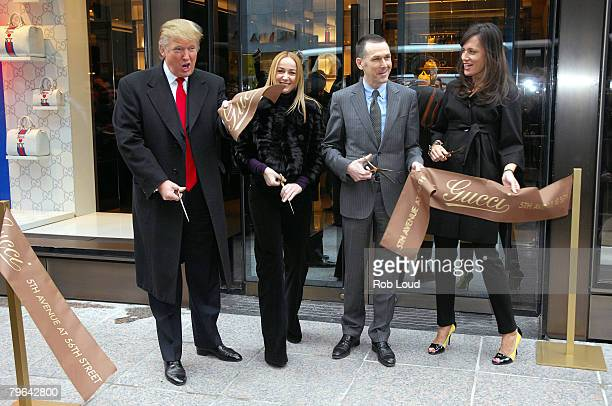 Donald Trump joins Gucci Creative Director Frida Giannini Gucci CEO Mark Lee and Gucci President Daniella Vitale for the new flagship store ribbon...