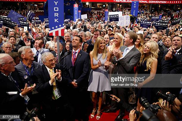 Donald Trump Jr along with Ivanka Trump Eric Trump and Tiffany Trump celebrate roll call putting Donald Trump over the 1237 delagates for nomination...