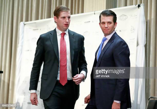 Donald Trump Jr and his brother Eric Trump leave the stage after a ceremony for the official opening of the Trump International Hotel Tower on...