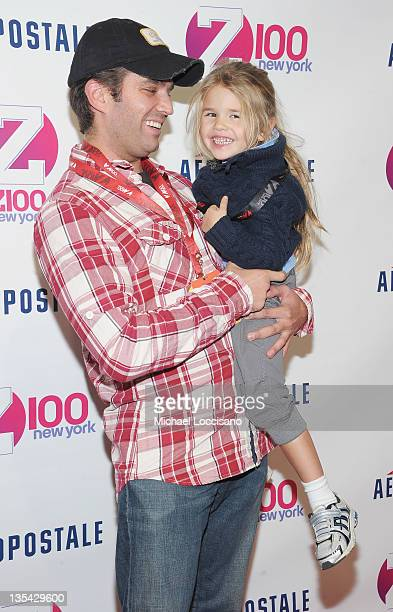 Donald Trump Jr and his daughter Kai Madison Trump attend Z100's Jingle Ball 2011 presented by Aeropostale Madison Square Garden on December 9 2011...