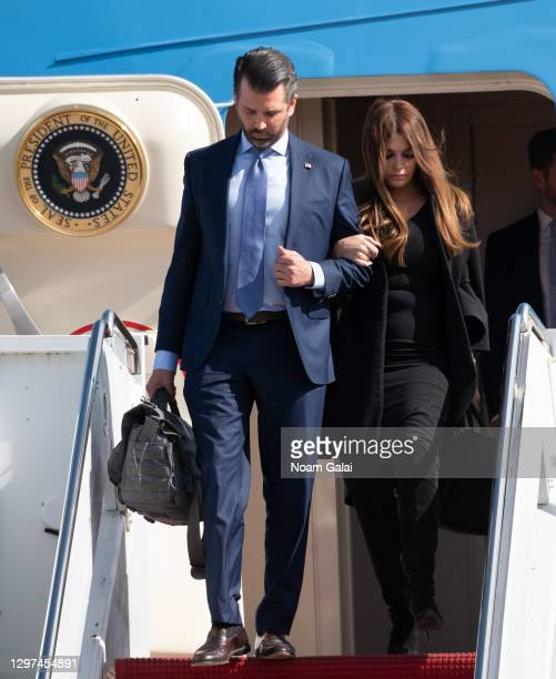 Donald Trump Jr. And Kimberly Guilfoyle exit Air Force One at the Palm Beach International Airport on the way to Mar-a-Lago Club on January 20, 2020...