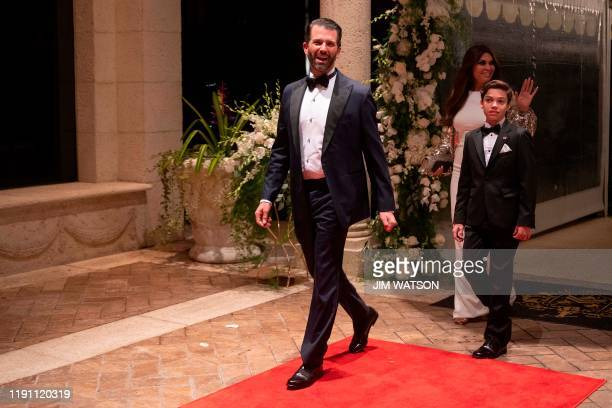 Donald Trump Jr arrives with his girlfriend journalist Kimberly Guilfoyle and her son Ronan Anthony Villency for a New Year's celebration at MaraLago...