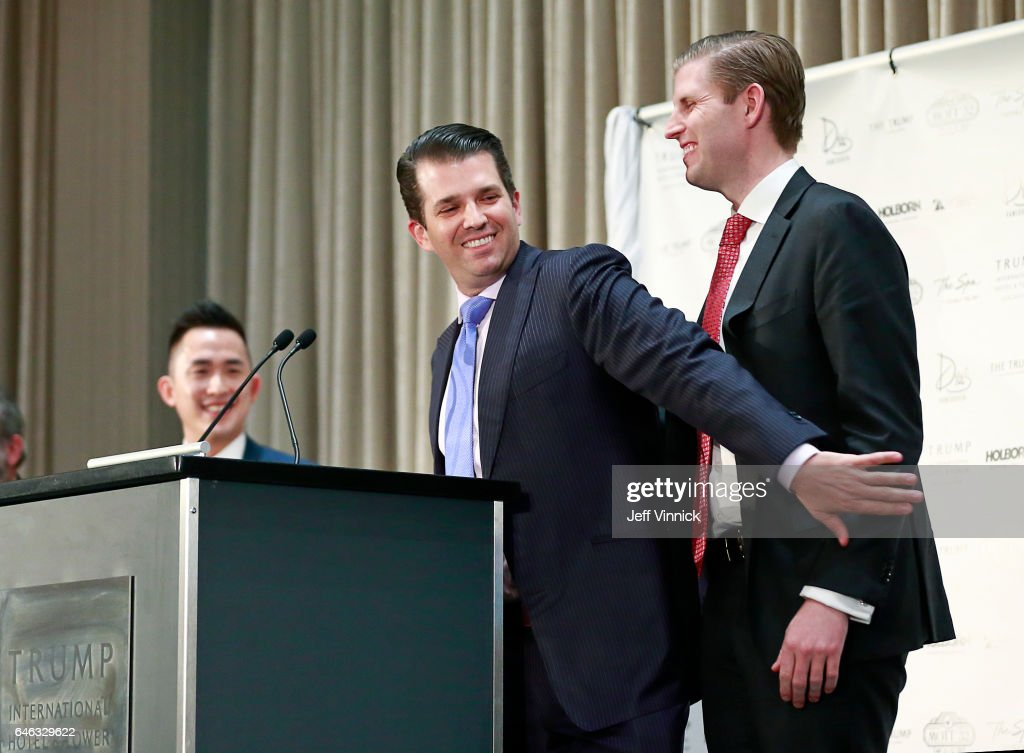 Donald Trump Jr. grabs his brother Eric Trump on the arm during a ceremony for the official opening of the Trump International Hotel & Tower on February 28, 2017 in Vancouver, Canada.