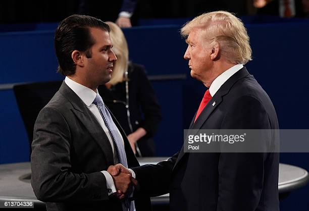 Donald Trump Jr greets his father Republican presidential nominee Donald Trump during the town hall debate at Washington University on October 9 2016...