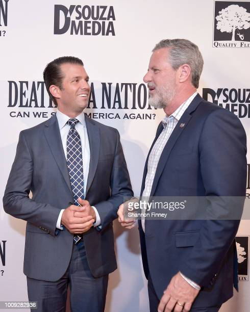 Donald Trump Jr greets Jerry Falwell Jr at the DC premiere of the film 'Death of a Nation' at E Street Cinema on August 1 2018 in Washington DC
