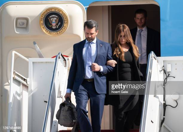 Donald Trump Jr., Kimberly Guilfoyle and Eric Trump exit Air Force One at the Palm Beach International Airport on the way to Mar-a-Lago Club on...