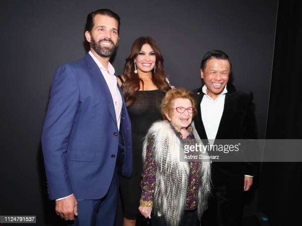 Donald Trump Jr Kimberly Guilfoyle Ruth Westheimer and Zang Toi pose backstage for Zang Toi fashion show during New York Fashion Week The Shows at...