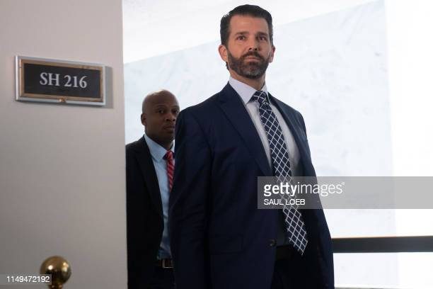 Donald Trump Jr leaves after testifying before the US Senate Select Committee on Intelligence on Capitol Hill in Washington DC June 12 2019 President...