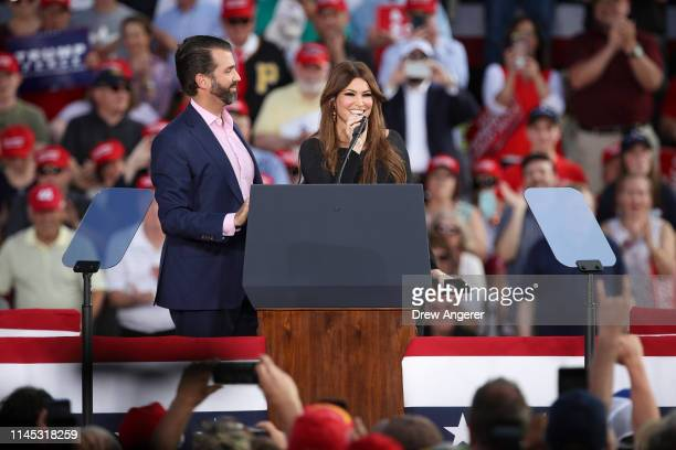 Donald Trump Jr looks on as Kimberly Guilfoyle speaks during a 'Make America Great Again' campaign rally at Williamsport Regional Airport May 20 2019...