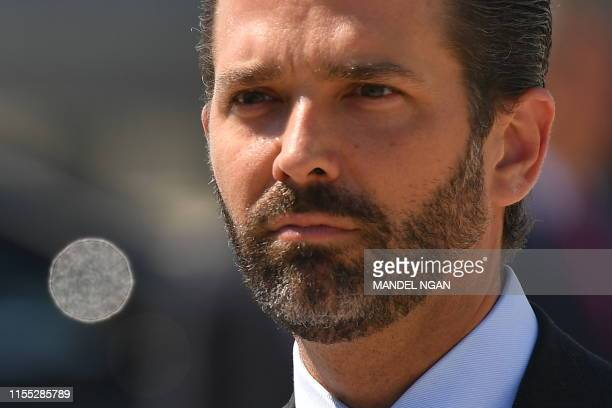 Donald Trump Jr looks on upon arrival at General Mitchell International Airport with US President Donald Trump in Milwaukee Wisconsin on July 12 2019...