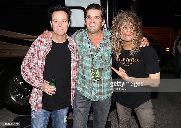 Donald Trump Jr poses with Bobby Dall and C C DeVille of Poison after their concert at Nassau Coliseum on July 20 2011 in Uniondale City