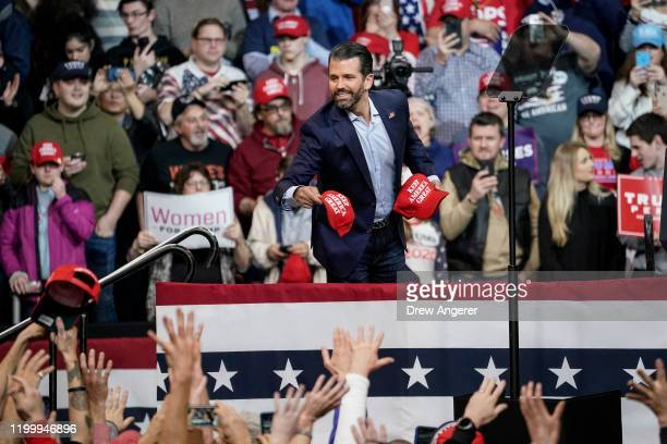 Donald Trump Jr tosses hats into the crowd during a rally at Southern New Hampshire University Arena on February 10 2020 in Manchester New Hampshire...