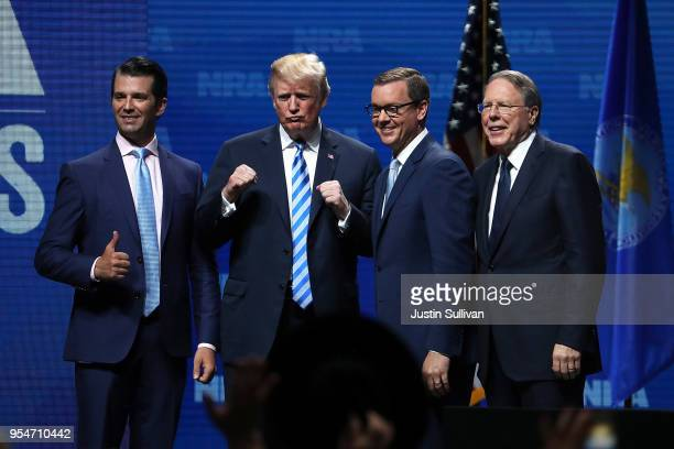 Donald Trump Jr US President Donald Trump Executive Director NRAILA Chris Cox and NRA Executive Vice President Wayne LaPierre greet the crowd at the...