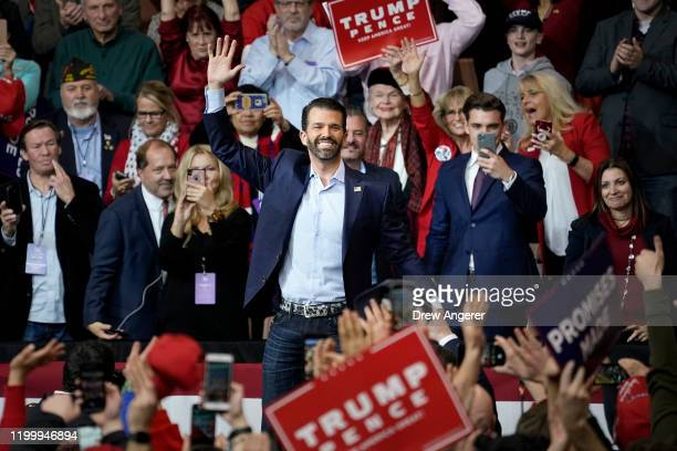 Donald Trump Jr waves to the crowd before speaking during a Keep America Great rally at Southern New Hampshire University Arena on February 10 2020...