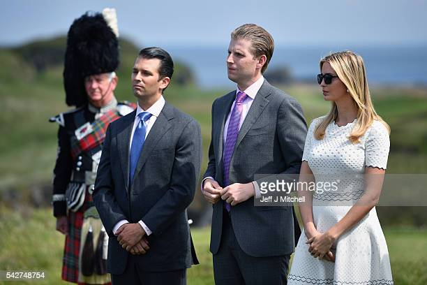 Donald Trump junior Eric Trump and Ivanka Trump listen to their father Presumptive Republican nominee for US president Donald Trump give a press...