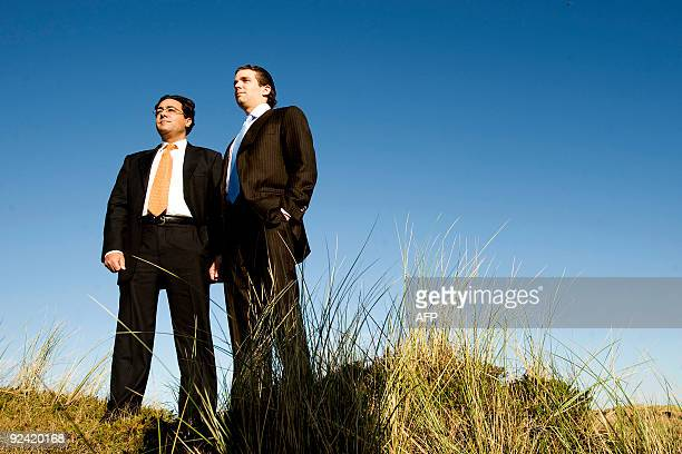 Donald Trump Junior is pictured with lawyer George Sorial at the Menie Estate Dunes as work begins on the golf course being built by his father US...