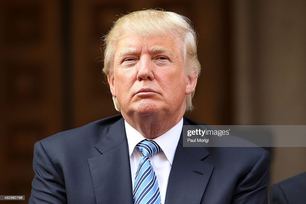 Donald Trump listens at the Trump International Hotel Washington, D.C Groundbreaking Ceremony at Old Post Office on July 23, 2014 in Washington, DC.