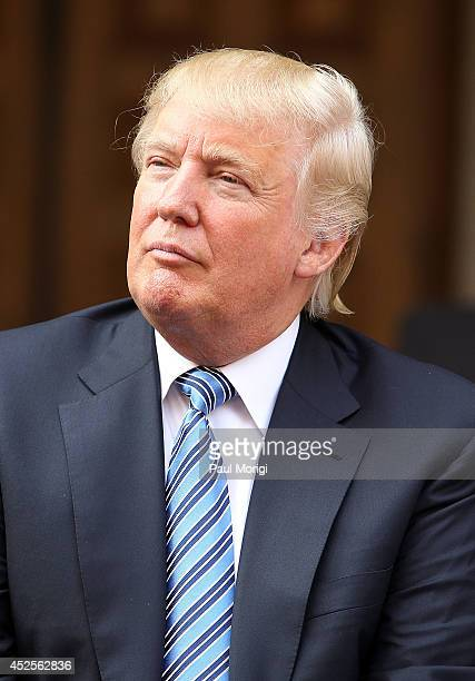 Donald Trump listens to remarks at the Trump International Hotel Washington DC Groundbreaking Ceremony at Old Post Office on July 23 2014 in...