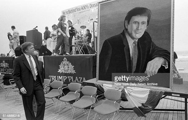 Donald Trump Looks at portrait during birthday party in his honor in Atlantic City NJ