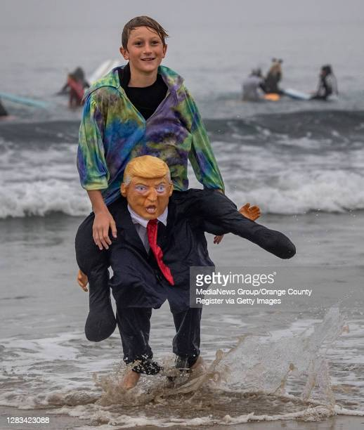 Donald Trump made an appearance at the Blackies 17th Annual Halloween Surf event in Newport Beach while carrying 11-year-old Hudson Wagner on his...