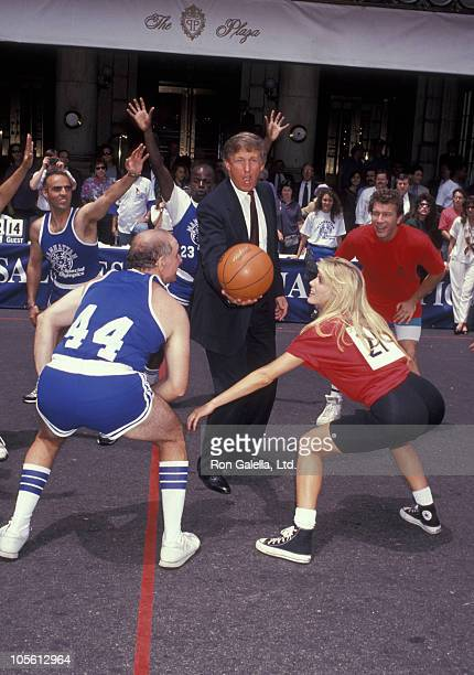 Donald Trump Marla Maples and players during HoopLa Basketball Tournament to Benefit The Special Olympics June 25 1992 at Plaza Hotel in New York...