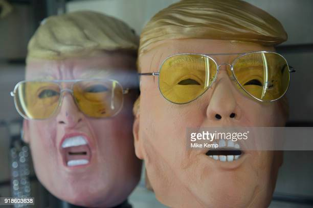 Donald Trump masks wearing yellow sunglasses in a shop window in London England United Kingdom