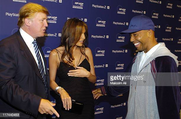 Donald Trump Melania Knauss and Russell Simmons during PLAYSTATION 2 and Russell Simmons Join HIPHOP Summit Action Network 2004 at Beverly Hills...
