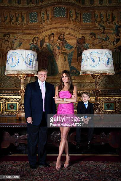 Donald Trump Melania Trump and Barron Trump pose during a photo shoot at the MaraLago Club on March 26 2011 in Palm Beach Florida Melania's clothes...
