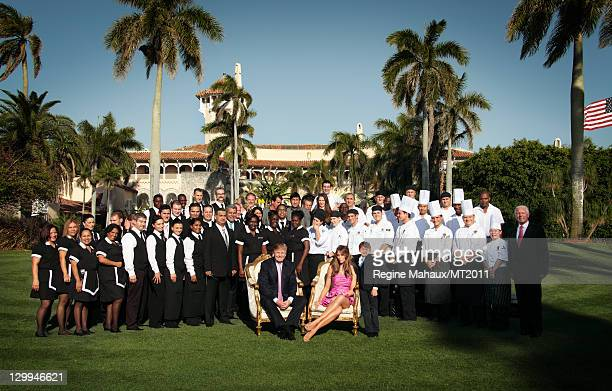 Donald Trump Melania Trump and Barron Trump pose with household staff during a photo shoot at the MaraLago Club on March 26 2011 in Palm Beach...