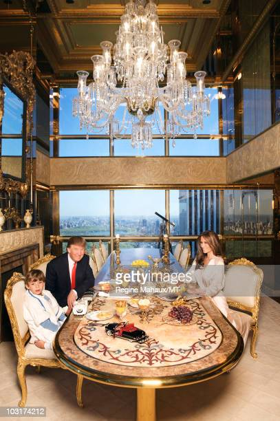 Donald Trump, Melania Trump and their son Barron Trump pose for a photo on April 14, 2010 in New York City. Donald Trump is wearing a suit and tie by...