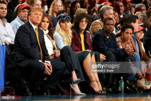 Donald Trump Melania Trump Howard Stern and and his girlfriend Beth Ostrosky and Chris Rock and his wife Malaak ComptonRock watch the game between...