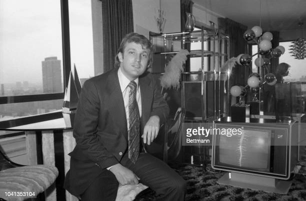 Donald Trump pauses in his apartment after receiving the news that the Board of Estimate unanimously approved a 40-year tax abatement plan. Under the...