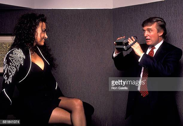 Donald Trump photographs aspiring Playboy model Lisa Madison during Playboy Magazine's 40th Anniversary Party May 3 1993 at the Park Hyatt Hotel in...