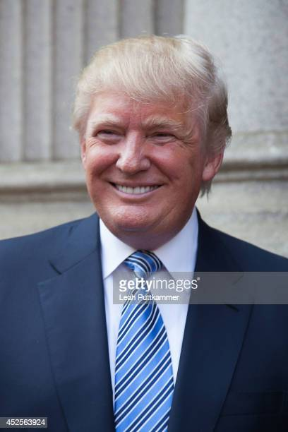 Donald Trump poses for a photo at the Trump International Hotel Washington, D.C Groundbreaking Ceremony on July 23, 2014 in Washington, DC.