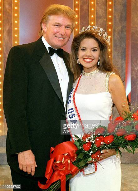 Donald Trump poses with Kimberly Ann Pressler Miss USA 1999 seconds after the crowning moment 05 February at The Grand Palace in Branson MO Pressler...