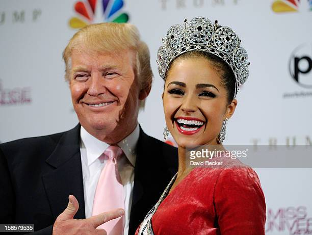 Donald Trump poses with Miss USA 2012 Olivia Culpo at a news conference after she was named the new Miss Universe during the 2012 Miss Universe...