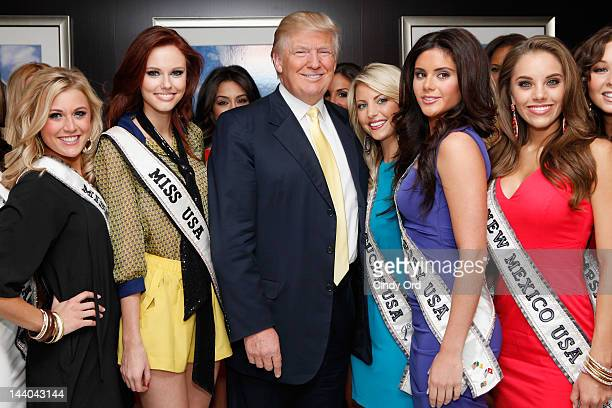 Donald Trump poses with Miss USA Contestants and Miss USA Alyssa Campanella at Trump Tower on May 8 2012 in New York City