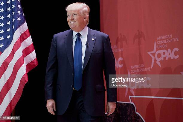 Donald Trump president and chief executive of Trump Organization Inc smiles while arriving to speak during the Conservative Political Action...