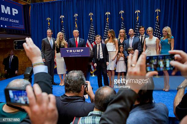 Donald Trump president and chief executive of Trump Organization Inc third left stands with family members including his son Donald Trump Jr left...