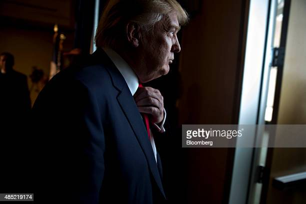 Donald Trump president and chief executive of Trump Organization Inc and 2016 Republican presidential candidate leaves a news conference ahead of a...