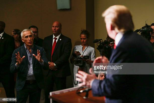 Donald Trump president and chief executive of Trump Organization Inc and 2016 Republican presidential candidate right talks with Jorge Ramos a news...