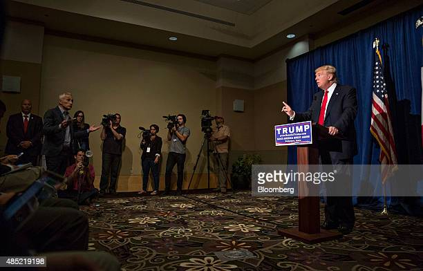 Donald Trump president and chief executive of Trump Organization Inc and 2016 Republican presidential candidate talks with Jorge Ramos a news anchor...