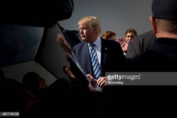 Donald Trump president and chief executive of Trump Organization Inc and 2016 Republican presidential candidate walks to his vehicle following a...