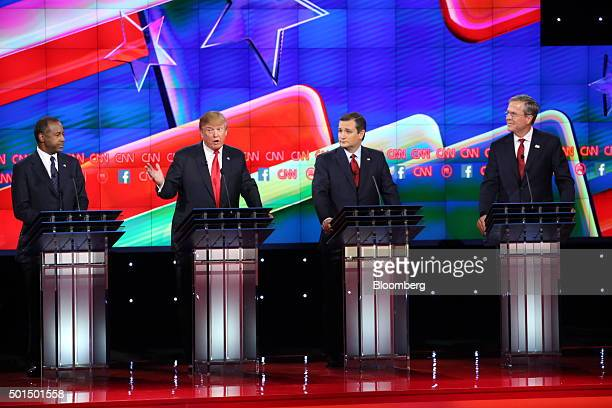 Donald Trump president and chief executive of Trump Organization Inc and 2016 Republican presidential candidate second left speaks as 2016 Republican...