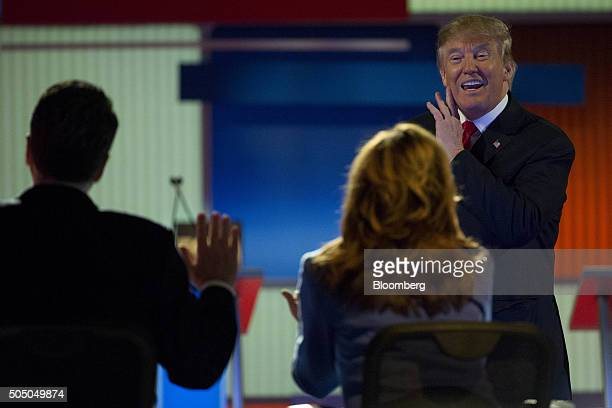 Donald Trump, president and chief executive of Trump Organization Inc. And 2016 Republican presidential candidate, right, talks to Fox Business...