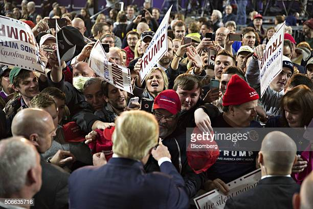 Donald Trump president and chief executive of Trump Organization Inc and 2016 Republican presidential candidate front center greets attendees during...