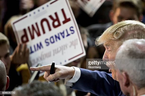Donald Trump president and chief executive of Trump Organization Inc and 2016 Republican presidential candidate right greets attendees during a...